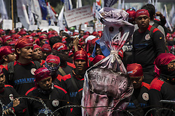 May 1, 2017 - Central Jakarta, Jakarta, Indonesia - Jakarta, Indonesia, 01 May 2017 : Thousands of Labor held demonstration in front of Horses statues round about at merdeka street-jakarta. They demand to go further approaching the Merdeka Palace but police already baricade with barbwire causing a little bit hard protest from labor by burning flowers that stand near by and some tools that they bring, police manage to put down the fire. (Credit Image: © Donal Husni via ZUMA Wire)
