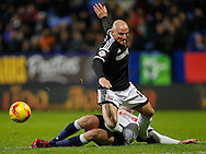 Alan McCormack of Brentford and Max Clayton of Bolton Wanderers during the Sky Bet Championship match between Bolton Wanderers and Brentford at the Macron Stadium, Bolton<br /> Picture by Mark D Fuller/Focus Images Ltd +44 7774 216216<br /> 30/11/2015