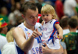 Dusko Savanovic of Serbia with his daughter after the basketball game between National basketball teams of Serbia and Turkey at FIBA Europe Eurobasket Lithuania 2011, on September 11, 2011, in Siemens Arena,  Vilnius, Lithuania. Serbia defeated Turkey 68-67. (Photo by Vid Ponikvar / Sportida)