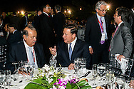 Presidents of Panama Juan Carlos Varela an Carlos Slim.  The Summits of the Americas, Dinner for business leaders at the Biomuseo, Panama 2015