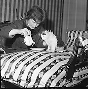 "Mrs. Beatrice Behan with 'Charlot"" the tom cat, who is entered in a Cat Show at the Mansion House , Kildare Street, Dublin..03.04.1962"