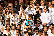 "01 FEBRUARY 2013 - PHNOM PENH, CAMBODIA:  Mourners on the street of Sisowath Quay, Phnom Penh's riverfront boulevard, watch the funeral procession of former King Norodom Sihanouk. Norodom Sihanouk (31 October 1922 - 15 October 2012) was the King of Cambodia from 1941 to 1955 and again from 1993 to 2004. He was the effective ruler of Cambodia from 1953 to 1970. After his second abdication in 2004, he was given the honorific of ""The King-Father of Cambodia."" Sihanouk died in Beijing, China, where he was receiving medical care, on Oct. 15, 2012. His cremation is will be on Feb. 4, 2013. Over a million people are expected to attend the service.   PHOTO BY JACK KURTZ"