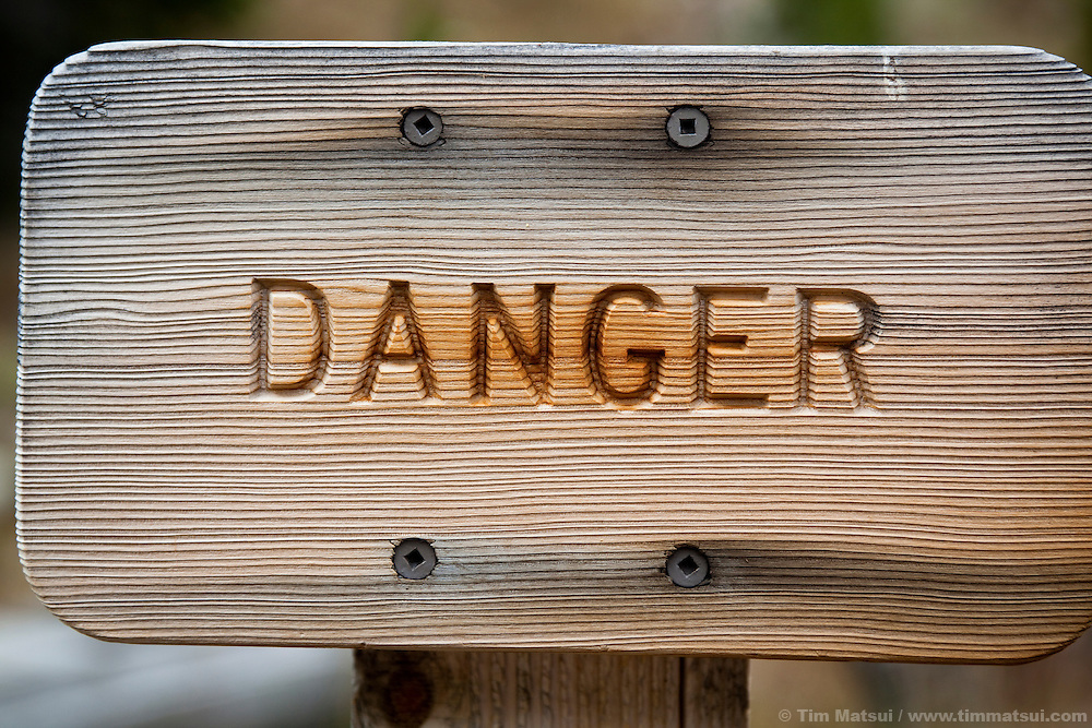 Wooden danger sign.