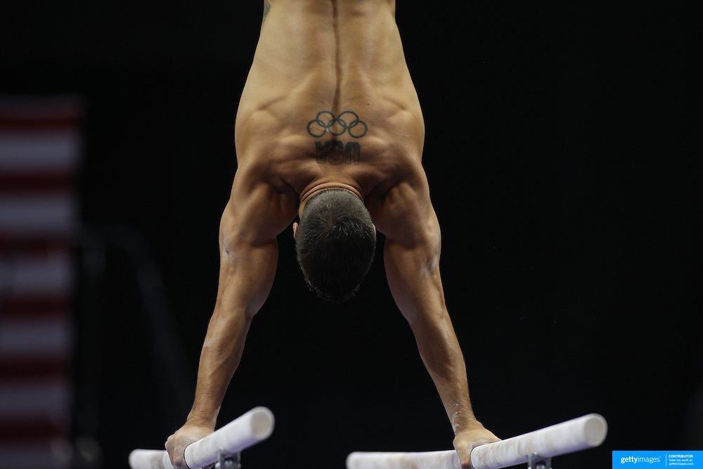 Jake Dalton, Norman, Oklahoma, shows his muscles and physique during warm up on the Parallel bars before competiton during the Senior Men Competition at The 2013 P&G Gymnastics Championships, USA Gymnastics' National Championships at the XL, Centre, Hartford, Connecticut, USA. 16th August 2013. Photo Tim Clayton