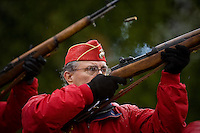 JEROME A. POLLOS/Press ..Russ DeVerniero, with the Pappy Boyington Detachment of the Marine Corps League, fires a round during a gun-salute during a Veteran's Day event Tuesday at Memorial Gardens Cemetery in Coeur d'Alene.