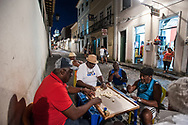 Playing dominoes in a midweek evening in Pelourinho