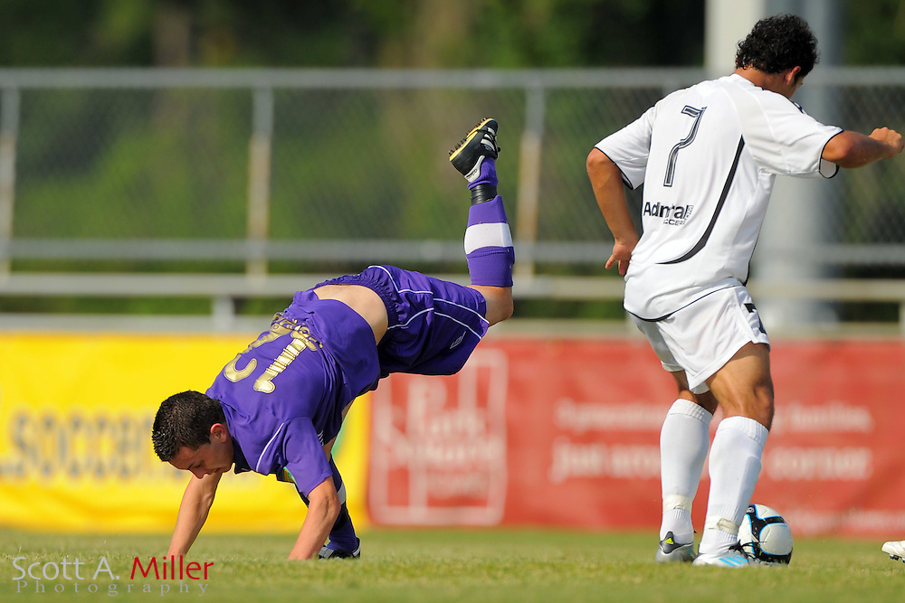 Orlando City U23s defender David Graydon (12)  and Ocala Stampede midfielder Douglas Dos Santos (7) in action at the Seminole Soccer Complex Saturday on May 26, 2012 in Sanford, Fla. ...©2012 Scott A. Miller..