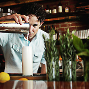 Daniel Sartain, owner and managing partner at Bar Virgile in Durham, makes a Ramos Gin Fizz on Wednesday, July 29, 2015.
