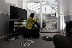 UK ENGLAND ROTHERHAM 29AUG14 - Jessica Jane (name used as an alias), 29, poses for a photo at her home in  Rotherham, epicentre of the largest child sex abuse scandal in Britain.<br /> <br /> <br /> <br /> Jessica became a victim of child sex grooming at the age of 14.<br /> <br /> An August 2014 report found that around 1,400 children had been sexually exploited in the town between 1997 and 2013, mainly by British-Pakistani men.<br /> <br /> <br /> <br /> jre/Photo by Jiri Rezac<br /> <br /> <br /> <br /> © Jiri Rezac 2014