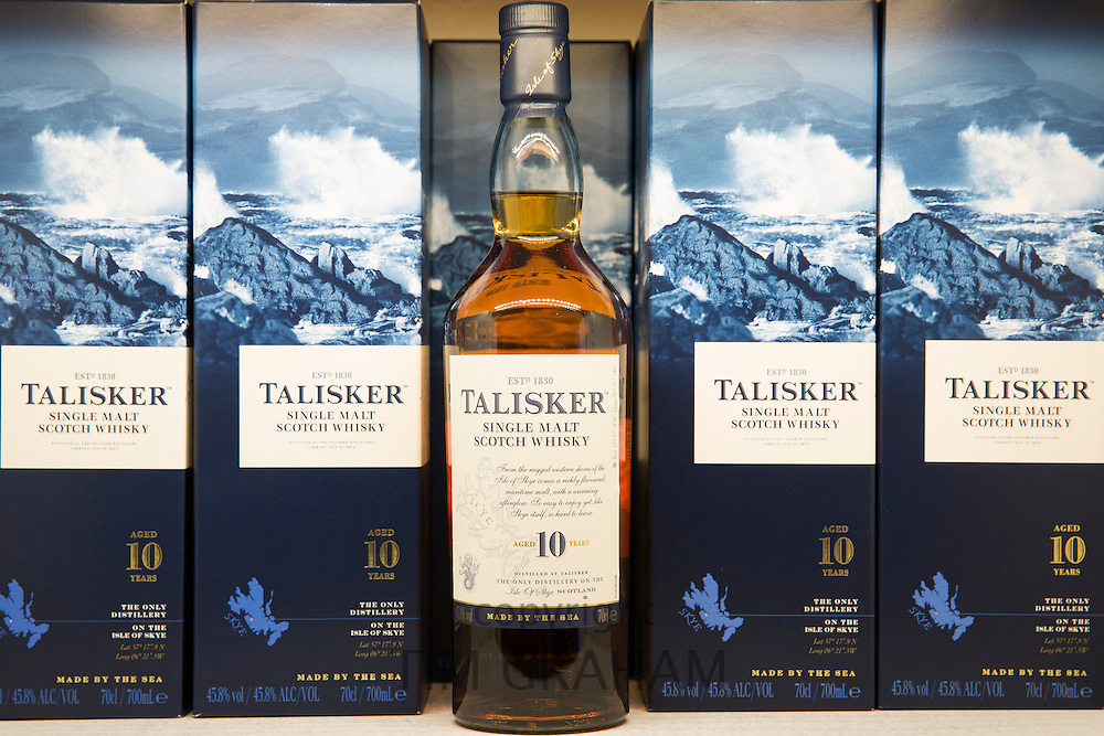 75cl bottles of 10-year-old Talisker single malt Scotch Whisky in cartons on display for sale at shop on visitors tour at Distillery in Carbost, Isle of Skye, Scotland