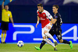 Mesut Ozil #11 of Arsenal F.C. and Josip Pivaric #19 of GNK Dinamo Zagreb during football match between GNK Dinamo Zagreb, CRO and Arsenal FC, ENG in Group F of Group Stage of UEFA Champions League 2015/16, on September 16, 2015 in Stadium Maksimir, Zagreb, Croatia. Photo by Urban Urbanc / Sportida