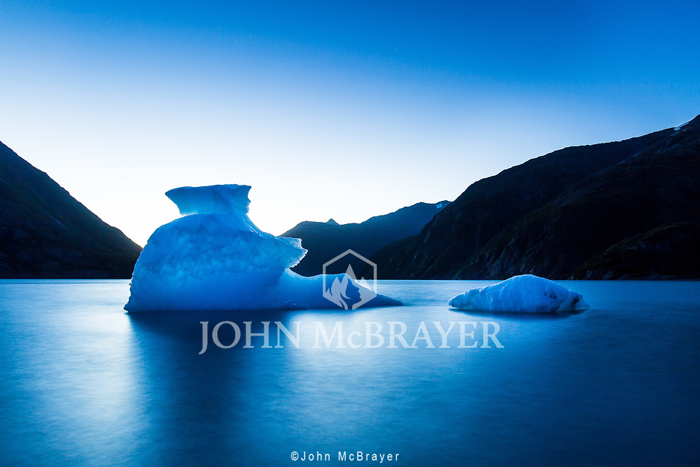 The long transition from day to night in the Alaskan fall enabled this long exposure of calved ice from Portage Glacier. © John McBrayer 2015