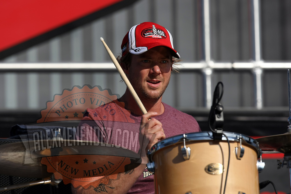 Scott Underwood of the Grammy award winning band Train, plays drums during a one hour performance prior to the start of the NASCAR Coke Zero 400 race at Daytona International Speedway in Daytona Beach, Fl., on Saturday July 7, 2012. (AP Photo/Alex Menendez) Grammy Award winning band TRAIN plays an hour long concert prior to the NASCAR Coke Zero 400 race at Daytona International Speedway in Daytona Beach, Florida on July 7, 2012.