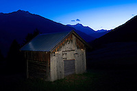 IFTE-NB-007872; Niall Benvie; Haybarn at night; above Fliess; Austria; Europe; Tirol; Fliesser Sonnenhänge; building; horizontal; spotlight; blue brown; upland mountain hill meadow; 2008; July; summer; night evening dusk; artificial light torch; agriculture; Wild Wonders of Europe Naturpark Kaunergrat