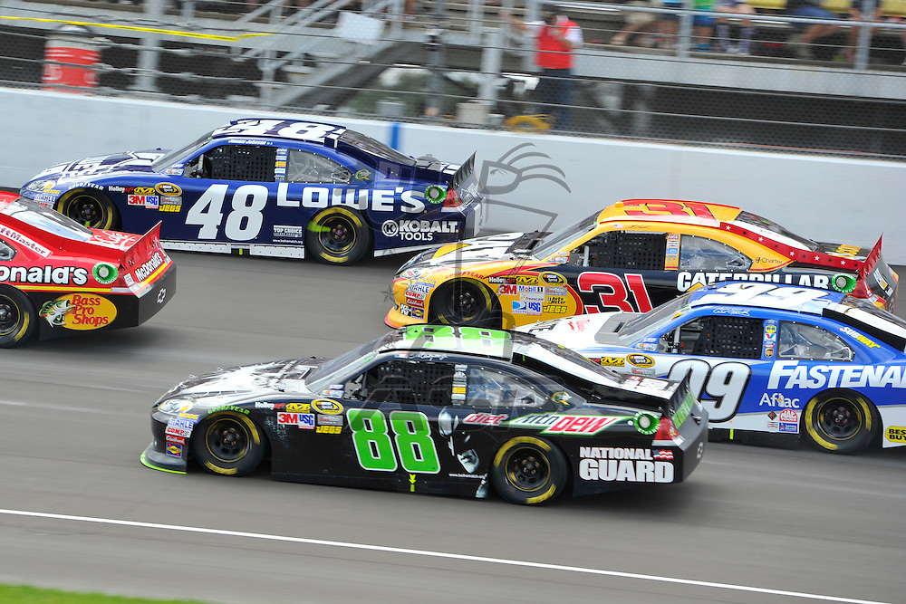 Brooklyn, MI - JUN 17, 2012: The Sprint Cup series races down the front stretch during race action for the Quicken Loans 400 race at the Michigan International Speedway in Brooklyn, MI.