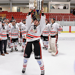 FORT FRANCES, ON - May 2, 2015 : Central Canadian Junior &quot;A&quot; Championship, game action between the Fort Frances Lakers and the Soo Thunderbirds, Championship game of the Dudley Hewitt Cup. Devin Shell #16 of the Soo Thunderbirds raises the Dudley Hewitt Cup.<br /> (Photo by Shawn Muir / OJHL Images)