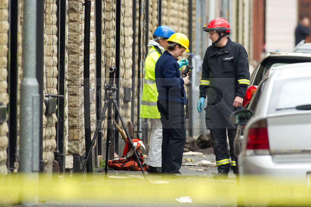 © Licensed to London News Pictures. 27/06/2012. Oldham , UK . A large explosion , believed to be caused by gas , has brought down at least one house in an Oldham terrace . Investigators survey the damage . Photo credit : Joel Goodman/LNP