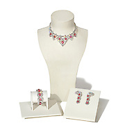 Set of ruby and diamond jewelry on white background