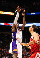 Jan. 6 2010; Phoenix, AZ, USA; Phoenix Suns forward Amare Stoudemire (1) puts up a shot against the Houston Rockets at the US Airways Center. Phoenix Suns defeated the Houston Rockets 118-110.  Mandatory Credit: Jennifer Stewart-US PRESSWIRE.