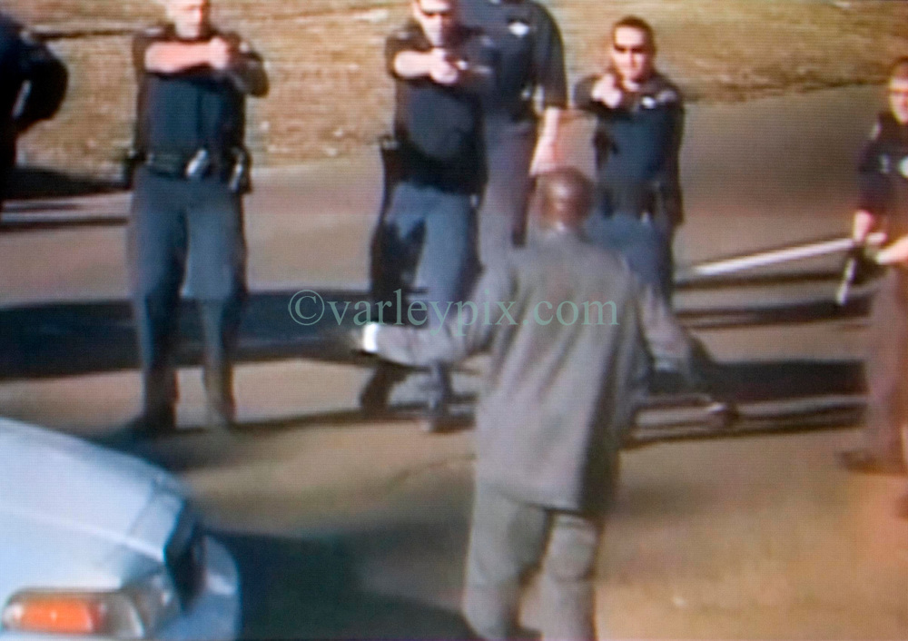 Dec 26th, 2005. New Orleans, Louisiana.<br /> Video grab showing knife wielding Anthony Hayes, (38 yrs) confronted by New Orleans police officers before he was gunned down on St Charles Avenue. <br /> Haynes Snr's son Cardell Hayes is accused of shooting and killing former New orleans Saint's Captain Will Smith dead April 9th 2016.<br /> Video grab courtesy New Orleans Channel 4 TV/varleypix.com