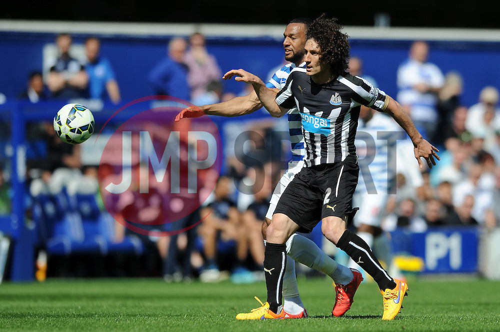 Queens Park Rangers' Karl Henry puts pressure on Newcastle United's Fabricio Coloccini - Photo mandatory by-line: Dougie Allward/JMP - Mobile: 07966 386802 - 16/05/2015 - SPORT - football - London - Loftus Road - QPR v Newcastle United - Barclays Premier League