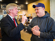 08 JANUARY 2020 - NEVADA, IOWA: Former Governor WILLIAM WELD (R-MA), left, talks to a man about biofuels and the environment during a campaign stop at Farm Grounds, a coffee shop in Nevada, IA. Weld, who was a two term Republican Governor of Massachusetts, is campaigning in Iowa in support of his primary challenge of Republican incumbent President Donald Trump.        PHOTO BY JACK KURTZ