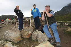 Tadgh Cotter Tim Halton and Frances Cotter  on the annual pilgrimage to Croagh Patrick yesterday.<br />