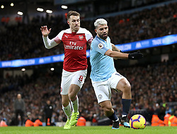 Manchester City's Sergio Aguero (right) and Arsenal's Aaron Ramsey battle for the ball during the Premier League match at the Etihad Stadium, Manchester.