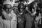 Three friends together outside a medical clinic in Dhaka, Bangladesh. (1975)