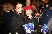 LONDON - December 17:<br /> L - Alicia Vikander and Helen McCrory reading at the Nordoff Robbins Christmas Carol Concert.<br /> 17, 12, 2013.<br /> St Luke's, London, United Kingdom<br /> (Photo  John Marshall/JM Enternational)