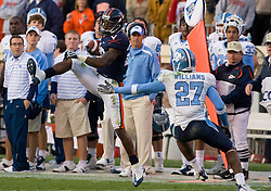 "Virginia wide receiver Kevin Ogletree (20) grabs a reception in front of North Carolina safety Deunta Williams (27).  The Virginia Cavaliers defeated the #18 ranked North Carolina Tar Heels 16-13 in overtime in NCAA football at Scott Stadium on the Grounds of the University of Virginia in Charlottesville, VA on October 18, 2008.  The 113th meeting of the two teams, dubbed the ""Oldest Rivalry in the South"", saw UVA continue its streak of consecutive home victories over UNC -- the last time the Tar Heels won in Charlottesville was 1981."