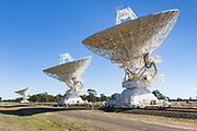Radio telescope microwave parabolic dish antennas at CSIRO Australia Telescope Compact Array in Narrabri, New South Wales, Australia.