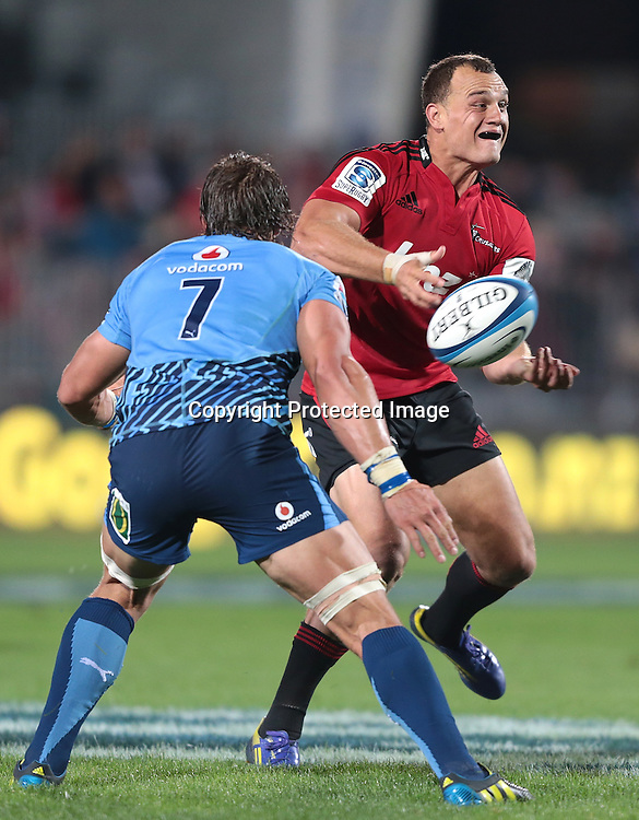 Israel Dagg of the Crusaders makes a break during the Super Rugby match between the Crusaders and the Bulls at AMI Stadium on Saturday March 15, 2013 in Christchurch, New Zealand. Photo: Martin Hunter/Photosport