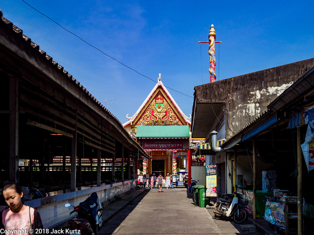 23 DECEMBER 2018 - CHANTABURI, THAILAND: People walk out of Wat Khetnaboonyaram, a Vietnamese Buddhist temple in Chantaburi. Chantaburi is the capital city of Chantaburi province on the Chantaburi River. Because of its relatively well preserved tradition architecture and internationally famous gem market, Chantaburi is a popular weekend destination for Thai tourists.   PHOTO BY JACK KURTZ