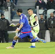 Gianluigi Buffon of Juventus saves from Sergio Aguero of Manchester City during the UEFA Champions League match at Juventus Stadium, Turin<br /> Picture by Stefano Gnech/Stella Pictures Ltd +39 333 1641678<br /> 25/11/2015
