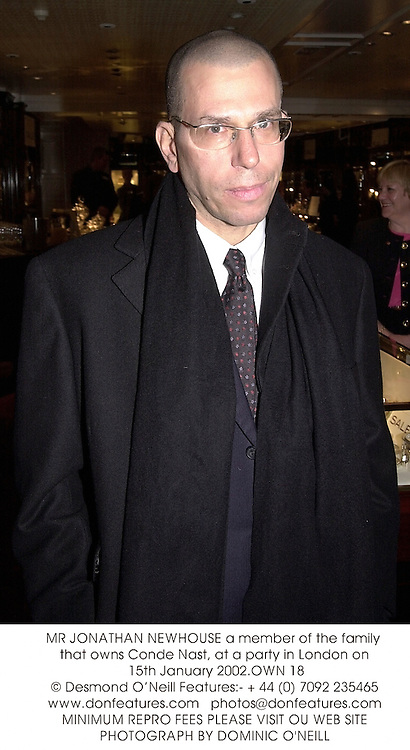 MR JONATHAN NEWHOUSE a member of the family that owns Conde Nast, at a party in London on 15th January 2002.OWN 18