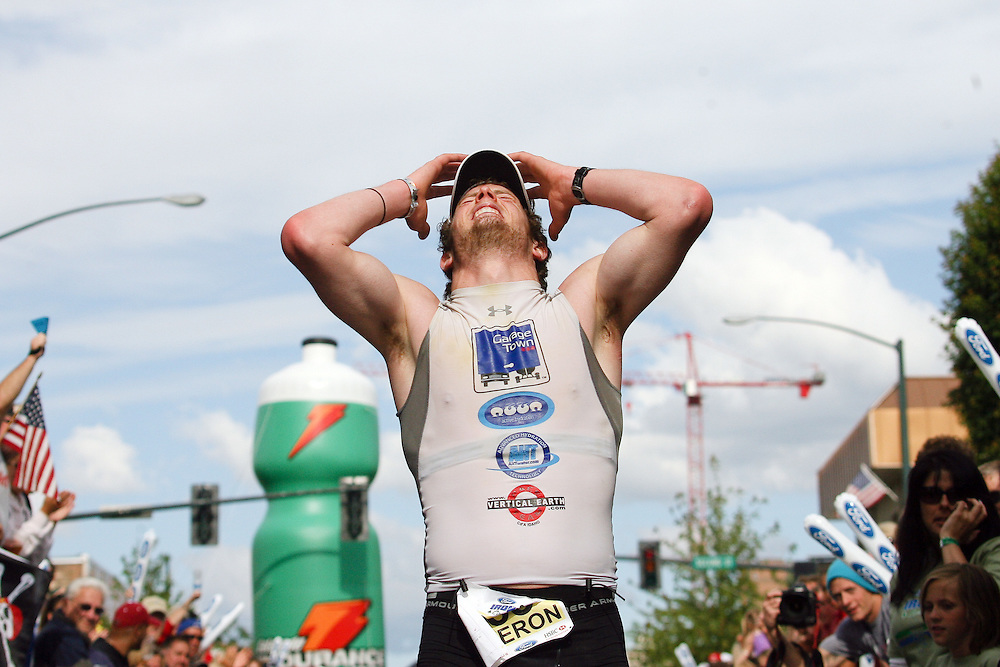 JEROME A. POLLOS/Press..Cameron Chesnut crosses the finish line in Sunday's Ironman Coeur d'Alene. The Post Falls resident was the first local finisher with a time of 10:05:13 for his first try at the event.