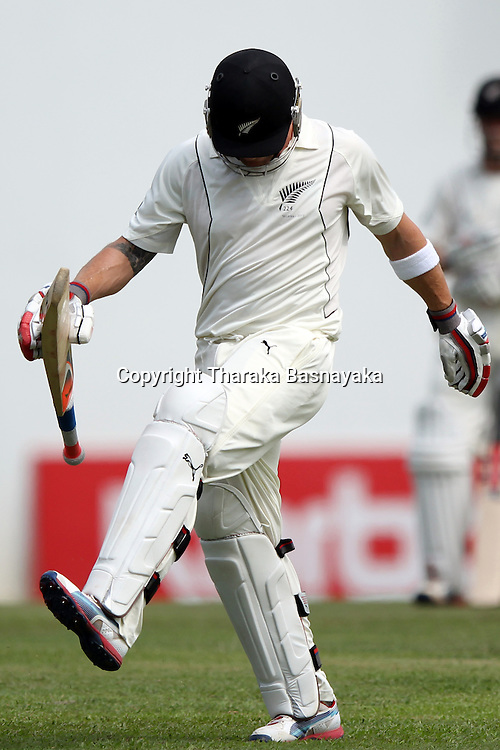 New Zealand cricketer Brendon McCullum reacts as he walks back to the pavilions after his dismissal during the first day of the second and final Test match between Sri Lanka and New Zealand at the P. Sara Oval Cricket Stadium in Colombo on November 25, 2012. New Zealand captain Ross Taylor won the toss and elected to bat.