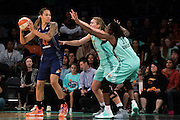 Carolyn Swords #8 and Tina Charles #31 of the New York Liberty double team Brittney Griner #42 of the Phoenix Mercury during the second round of the WNBA Playoffs at Madison Square Garden in New York on September 24, 2016. (Cooper Neill for The New York Times)