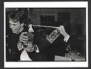Clive Cooke sprayed with a soda siphon at a party organised by Oliver Baxter. 149 Grosvenor St. London. 13 November 1981, Exhibition in a Box