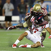 Mississippi Rebels tight end Evan Engram (17) gets tackled by Florida State Seminoles defensive back Trey Marshall (20) during an NCAA football game between the Ole Miss Rebels and the Florida State Seminoles at Camping World Stadium on September 5, 2016 in Orlando, Florida. (Alex Menendez via AP)