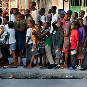 Long queues for a hot meal distribution in Port-au-Prince.