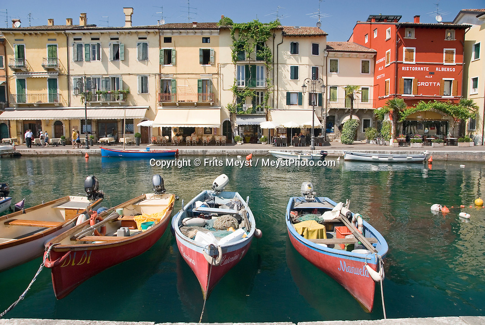 Lacize, Lago di Garda, Italy, May 2009. The medieval town of Lacize, with its historical center and marina with fishing boats. The northern part of the lake area is loved by sportive people, while the south is known for its relxed atmosphere. Photo by Frits Meyst/Adventure4ever.com