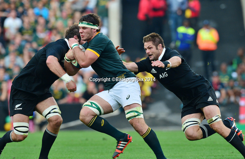 Marcell Coetzee of South Africa tackled by Sam Whitelock of New Zealand and Richie McCaw of New Zealand during the Castle Lager Rugby Championship match between South Africa and New Zealand at Ellis Park on 04 October 2014 © Gavin Barker/BackpagePix