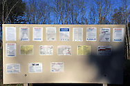 Various government notices including from OSHA, NC Dept of Revenue, eVerify, US Dept of Labor, and so on. All on one large signed posted at a construction site in catawba County, NC