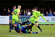 AFC Wimbledon striker Tyrone Barnett (23) battles for possession in the box during the EFL Sky Bet League 1 match between AFC Wimbledon and Peterborough United at the Cherry Red Records Stadium, Kingston, England on 17 April 2017. Photo by Matthew Redman.