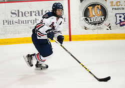 March 13 2016: Robert Morris Colonials defenseman Evan Moore (5) skates the puck up ice during the second period in game three of the Atlantic Hockey quarterfinals series between the Bentley Falcons and the Robert Morris Colonials at the 84 Lumber Arena in Neville Island, Pennsylvania (Photo by Justin Berl)