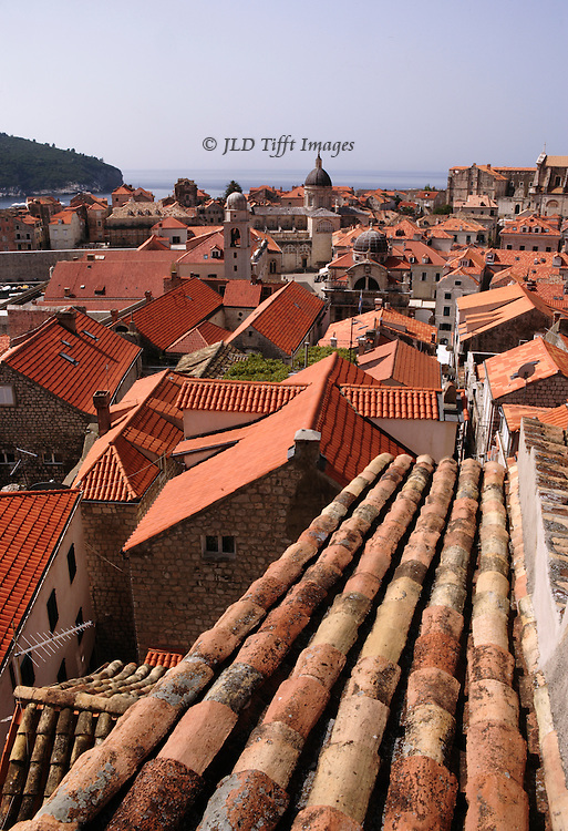 Restored Dubrovnik homes have largely new roofs,made from tiles specially manufactured in Spain by original methods.  Citizens saved many of the original roof tiles, however, and these are used when visible wherever possible, while the new tiles have been set underneath them.