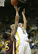 25 JANUARY 2007: Iowa forward Krista VandeVenter (51) shoots in front of Minnesota guard Korinne Campbell (5) in Iowa's 80-78 overtime loss to Minnesota at Carver-Hawkeye Arena in Iowa City, Iowa on January 25, 2007.