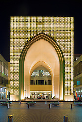 exterior night view of Dubai Mall, the world's largest, in Dubai United Arab Emirates